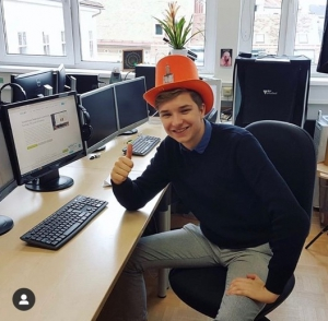 First day of work, wearing the offices 'crazy hat'